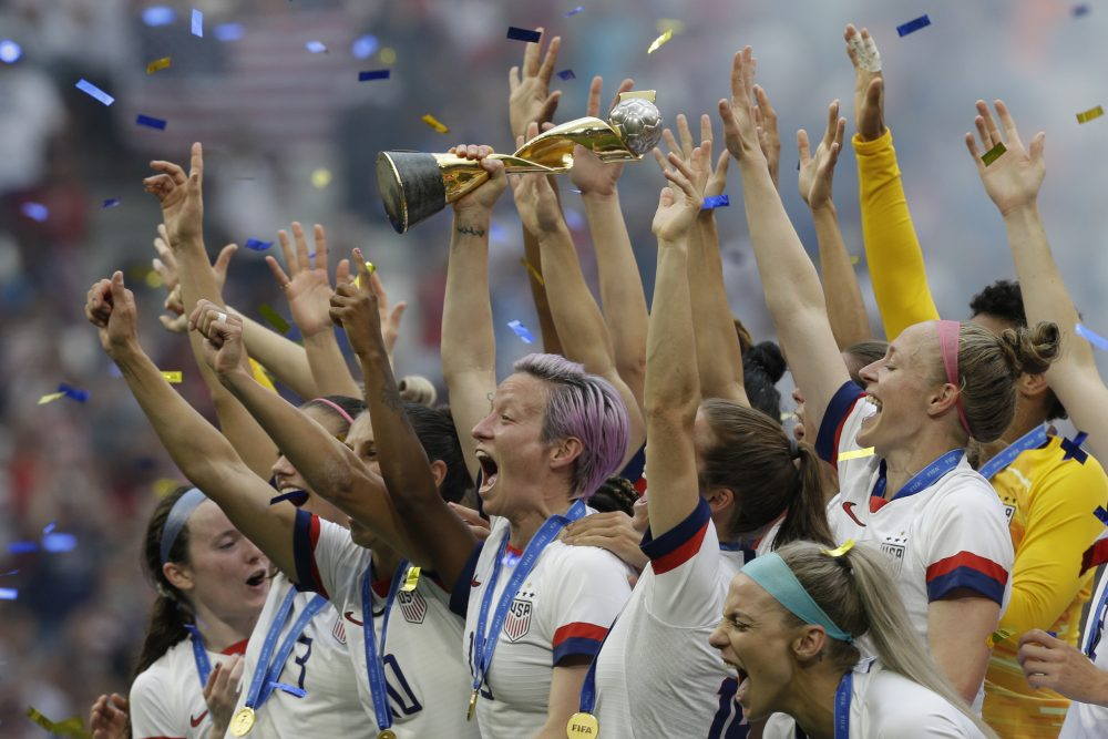 In this July 7, 2019, file photo, U.S. player Megan Rapinoe holds the trophy after winning the Women's World Cup final soccer match against The Netherlands at the Stade de Lyon in Decines, outside Lyon, France.