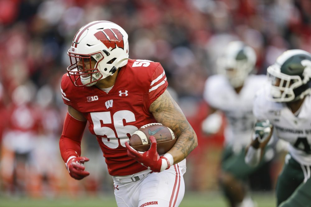 Wisconsin linebacker Zack Baun (56) returns an interception for a touchdown against Michigan State wide receiver C.J. Hayes (4) during the second half of an NCAA college football game Saturday, Oct. 12, 2019, in Madison, Wis. Wisconsin won 38-0. (AP Photo/Andy Manis)