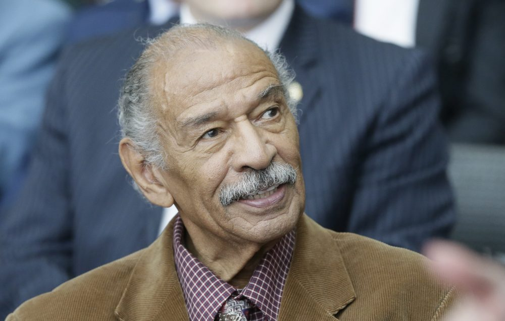 U.S. Rep. John Conyers attends a ceremony for former U.S. Sen. Carl Levin in April 2016 in Detroit. Detroit police say the former congressman died at his home on Sunday. He was 90.