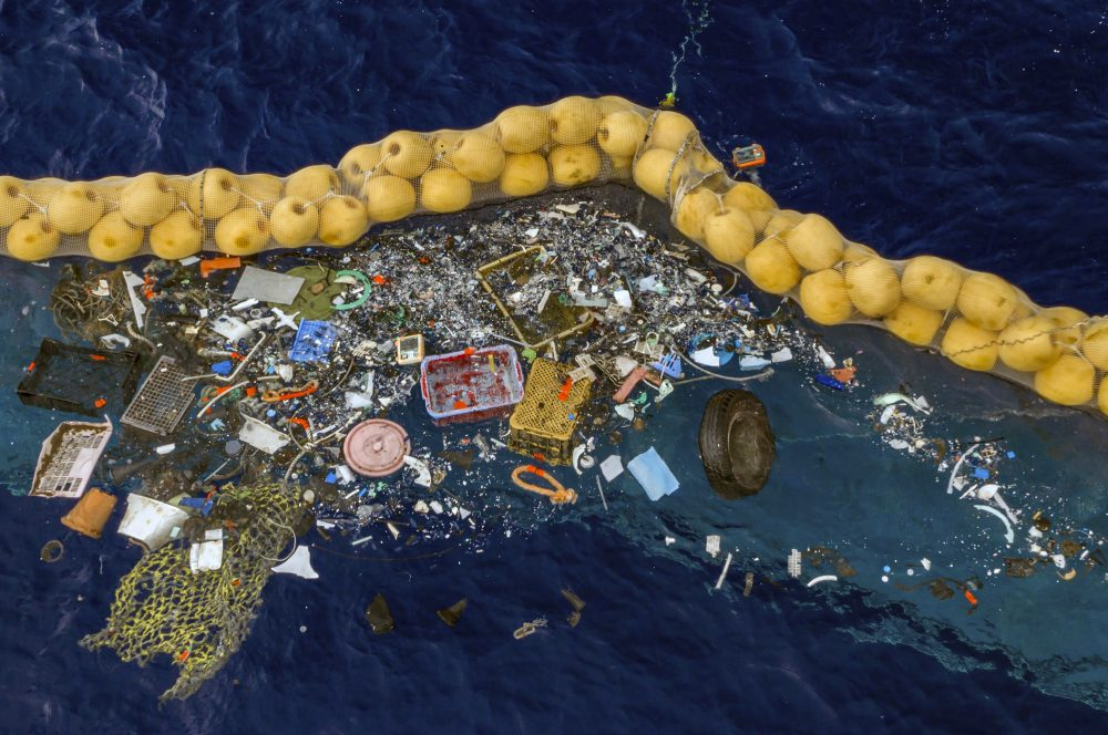 Plastic is retained in front of an extended cork line in the Pacific Ocean. A Dutch inventor Boyan Slat says that after a series of setbacks his system for catching plastic floating in the Pacific between California and Hawaii is now working.