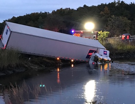 A tractor-trailer truck crashed into the water along Route 1 near the Taste of Maine in Woolwich early Thursday morning.