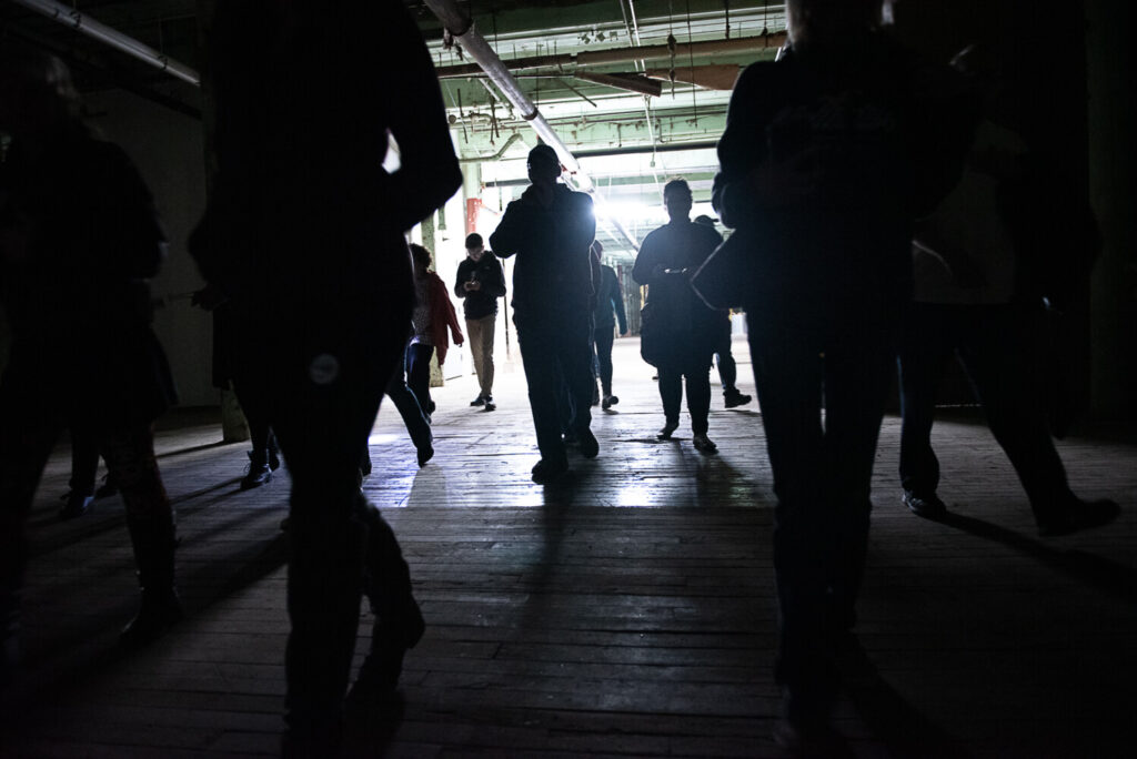 Visitors walk through the basement of the Bates Mills on Saturday evening with the Maine Ghost Hunters, who have been invited to investigate possible paranormal activity.