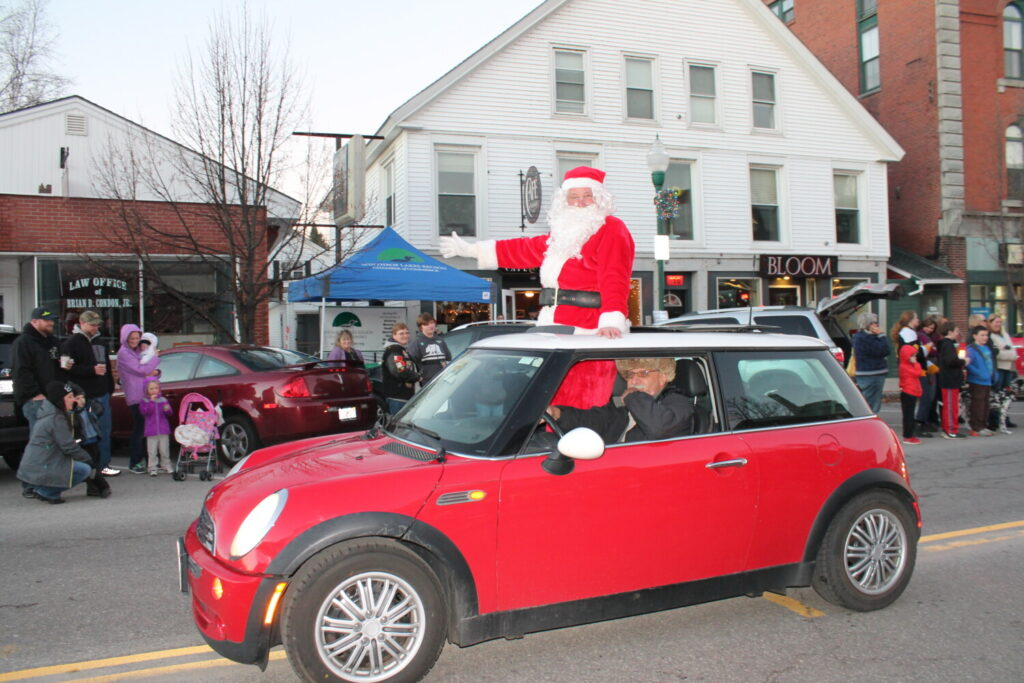 Santa waves to the crowd at a previous Winthrop Holiday Parade. George Szadis, of Winthrop, was his chauffeur.