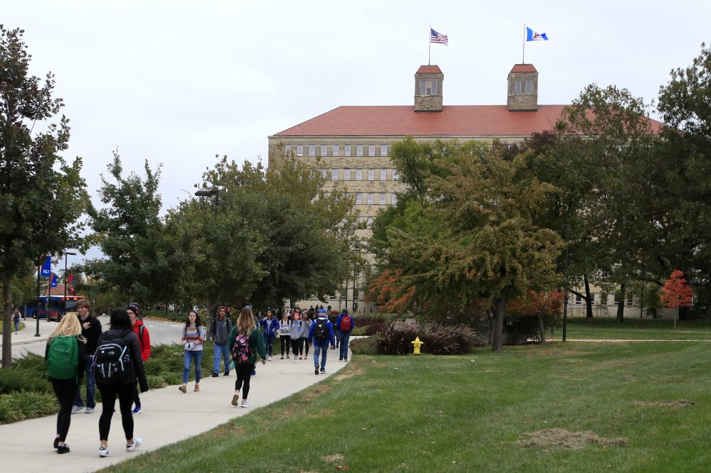 In this Oct. 24, 2019, file photo students walks in front of Fraser Hall on the University of Kansas campus in Lawrence, Kan. Americans collectively owe nearly $1.5 trillion in student loans, more than twice the total a decade ago.