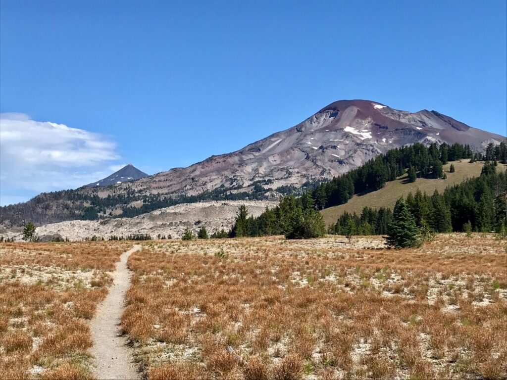 In central Oregon, the Pacific Crest Trail traverses the Three Sisters Wilderness. Pictured here is South Sister (10,363 feet) and North Sister (10,090 feet), the state's third and fourth highest peaks respectively.