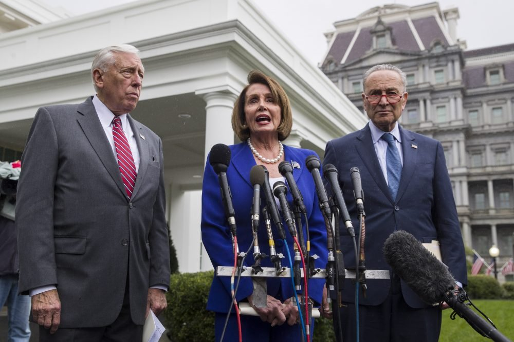 House Majority Leader Steny Hoyer of Maryland, left, House Speaker Nancy Pelosi of California, and Senate Minority Leader Chuck Schumer of New York speak with reporters Wednesday after a meeting with President Trump at the White House in Washington.