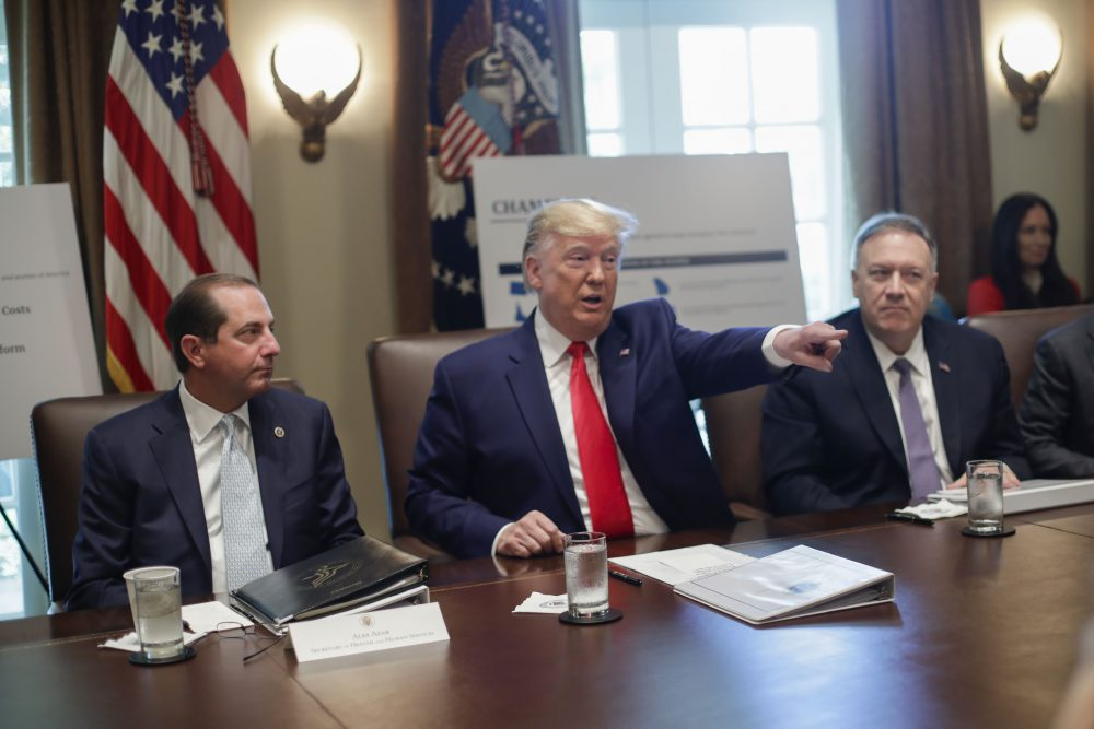 President Trump, center, points to members of his Cabinet while speaking during a Cabinet meeting Monday in the Cabinet Room of the White House, as Health and Human Services Secretary Alex Azar, left, and Secretary of State Mike Pompeo, right, listen.