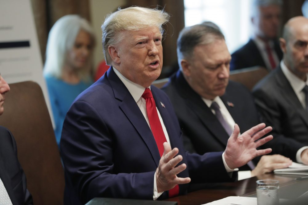 President Trump speaks at Monday's Cabinet meeting at the White House. Secretary of State Mike Pompeo is at right.
