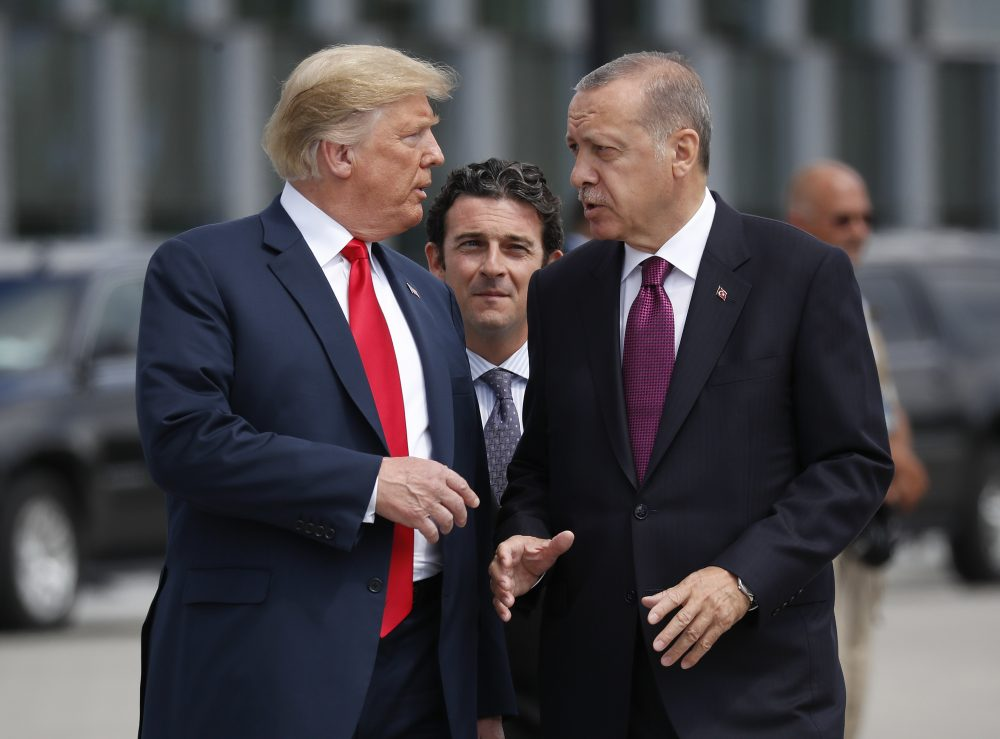 President Donald Trump, left, talks with Turkey's President Recep Tayyip Erdogan in July, 2018. The White House says Turkey will soon invade Northern Syria, casting uncertainty on the fate of the Kurdish fighters allied with the U.S. against in a campaign against the Islamic State group.