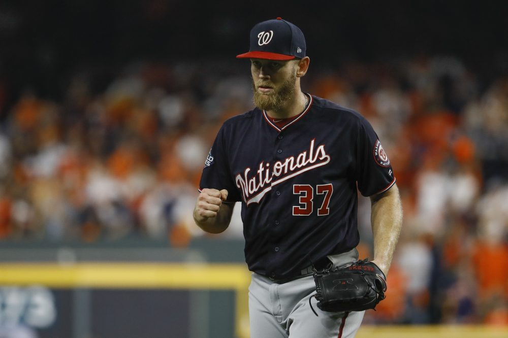 Nationals starter Stephen Strasburg reacts after getting the Astros' Michael Brantley to ground out to end the fifth inning of Game 6 of the World Series on Tuesday night in Houston. Washington won to force a decisive Game 7 on Wednesday night.