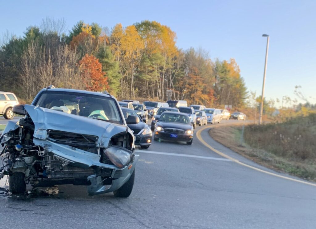 A car's front end is smashed following a crash Thursday morning on the Exit 112 off-ramp for Interstate 95 and Civic Center Drive.