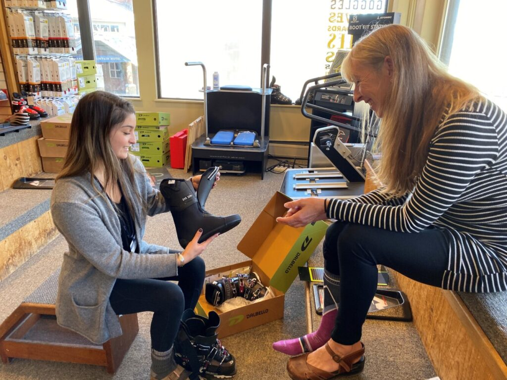 Gayle Labrecque, right, gets fitted for new boots by Anna Drumster, certified boot fitter at Downhill Supply Co. at Sugarloaf Mountain.