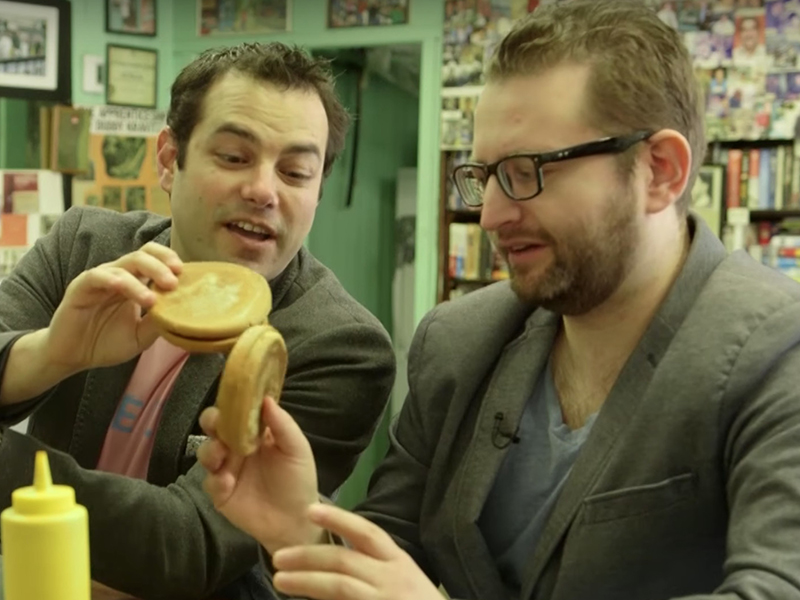 "Jamie Elman and Eli Batalion sample salami-baloney sandwiches at Wilensky's in a scene from the documentary ""Chewdaism: A Taste of Jewish Montreal."" The movie is screening in Portland in November."