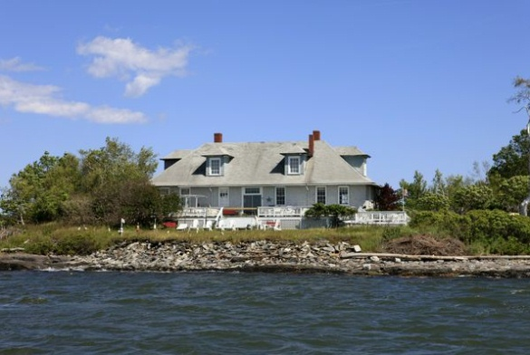 A house on Casco Bay's House Island, where quarantined immigrants received medical care, is part of the property sold last week to a Portland entrepreneur.