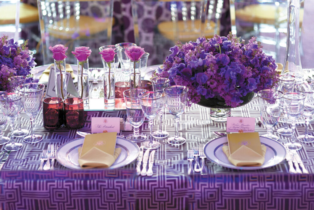 Bryan Rafanelli designed seven state dinners for the Obamas, including the one in honor of David Cameron, where White House tables were decorated with purple roses and lilacs and a splash of green.