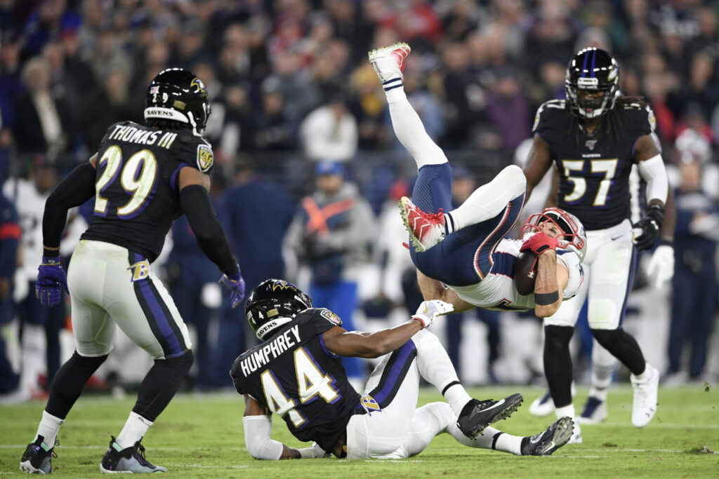 Julian Edelman and the New England Patriots were upended by Marlon Humphrey, center, and the Baltimore Ravens on Sunday night.