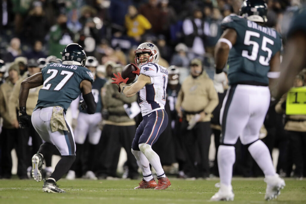 Patriots receiver Julian Edelman throws a touchdown during New England's 17-10 win over the Philadelphia Eagles on Sunday in Philadelphia.