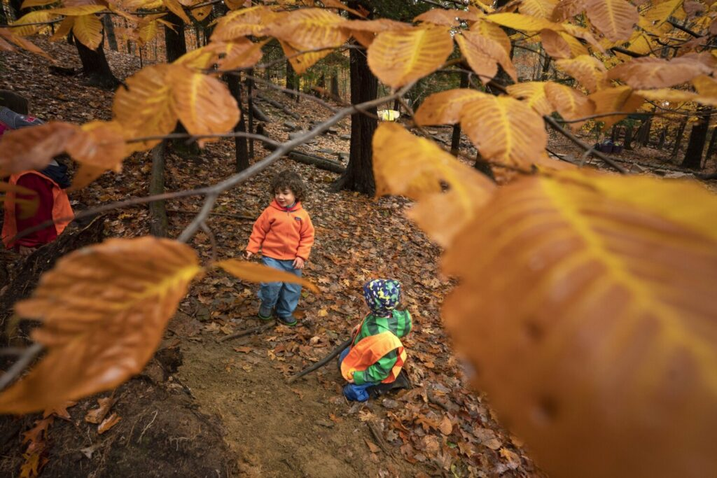 Jake Girard, left, and Ayden Olsen, both 4, play at a dirt mound at TimberNook of Greater Portland in Gorham. The TimberNook program uses a nature-based approach to foster creativity and imagination in children.