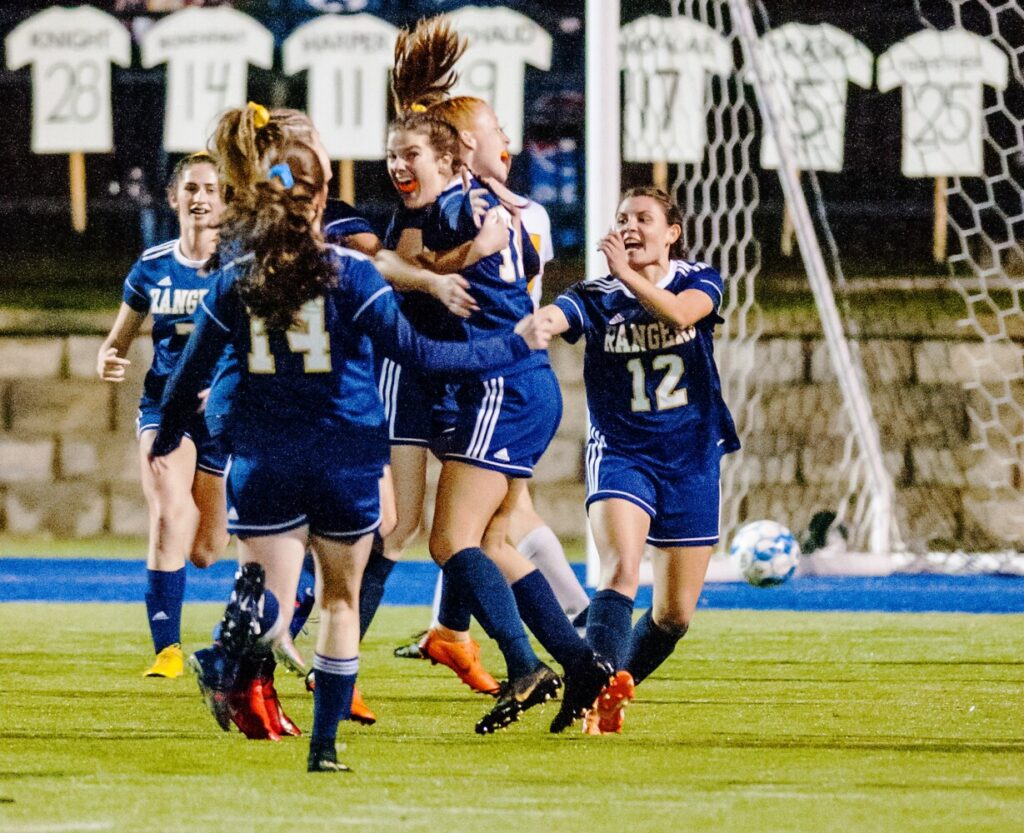 Traip Academy celebrates after a goal by Sophia Sanataria against Maranacook in the first half of the Class C South girls championship Tuesday in Lewiston.