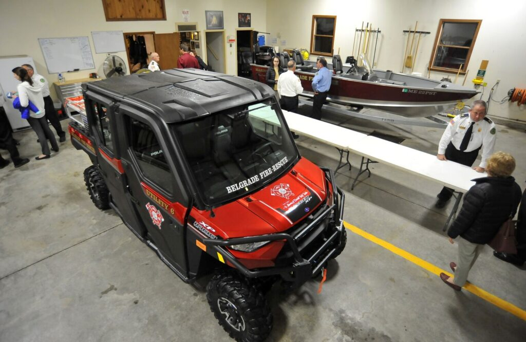 Belgrade firefighters examine a new firefighting ATV and rescue boat Monday at the Belgrade Lakes Fire Department in Belgrade.