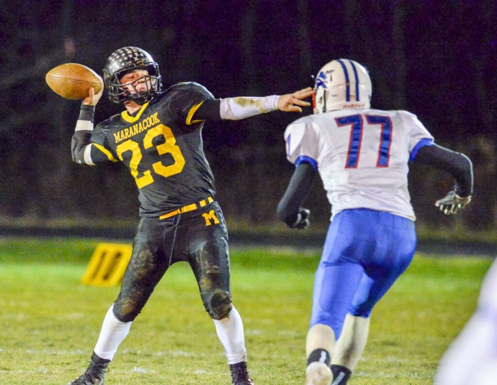 Maranacook quarterback Garit Laliberte, left, throws a pass in front of Mt. Ararat defender Damien Weed during the eight-man large school championship game earlier this season at the Ricky Gibson Field of Dreams in Readfield.