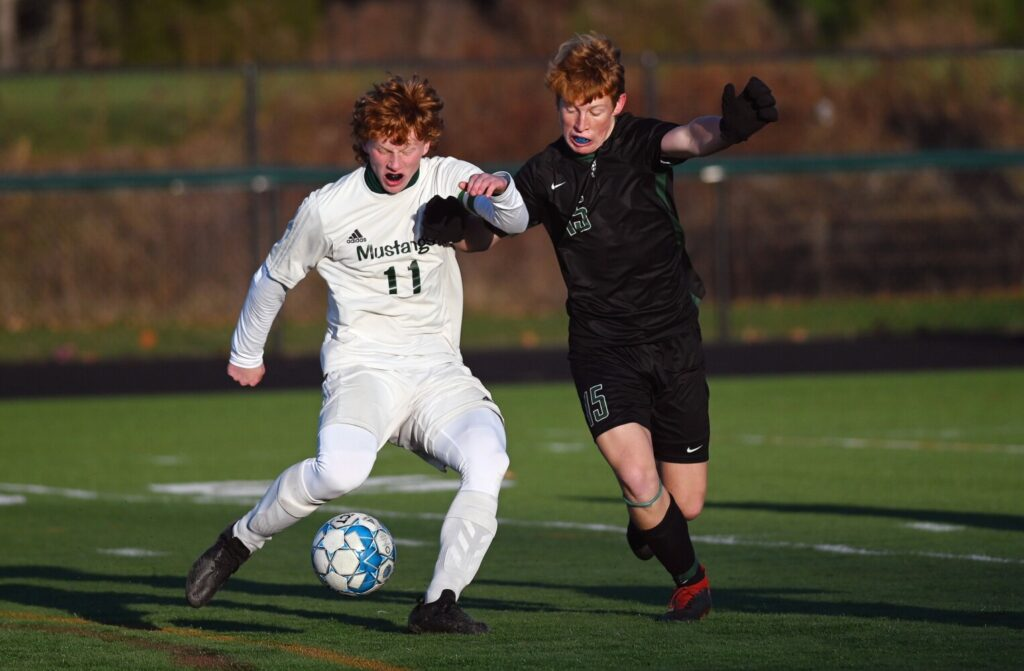 Mount View's Elijah Allen (11) battles for the ball with Waynflete's Roan Hopkins in the Class C state championship Saturday in Falmouth.