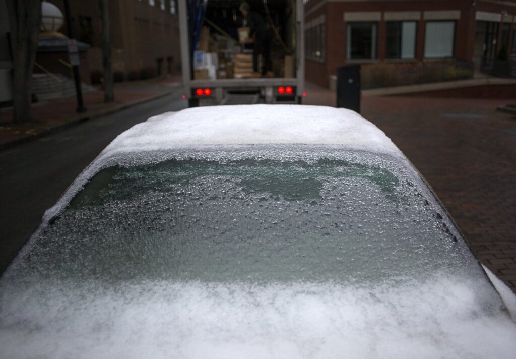 A parked car is encased in ice after freezing rain coated Portland overnight and into the morning on Tuesday. Much of Maine got much worse, but a cold-weather record was set at the Portland International Jetport, where the high temperature for Tuesday was just 33 degrees.