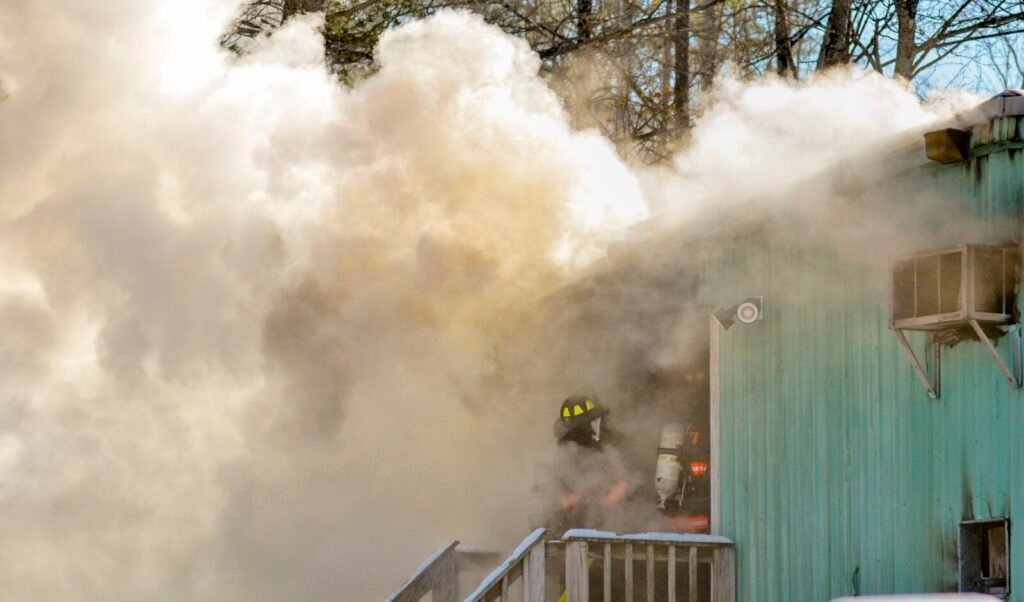 Firefighters battle a blaze Wednesday at CCC Construction in Augusta.