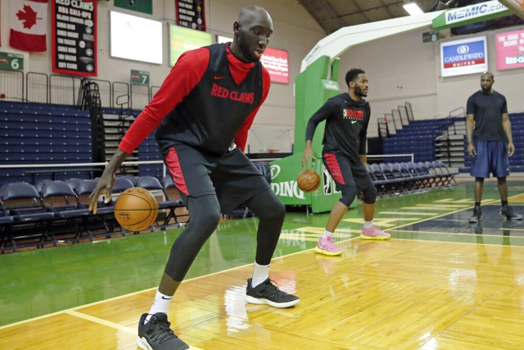 Tacko Fall, left, and Yante Maten work on dribbling skills on Thursday at Portland Expo.