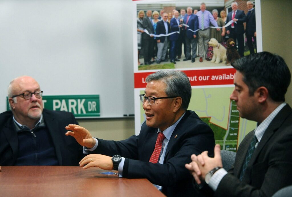 Yonghyon Kim, consul general of the Republic of Korea, center, fields questions from the media Tuesday while sitting with FirstPark executive director Jim Dinkle, left, and Garvan Donegan, of the Central Maine Growth Council, at FirstPark in Oakland.