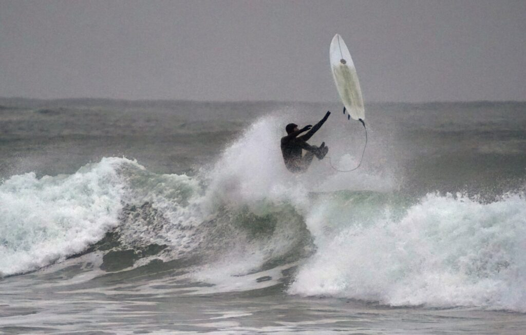A surfer comes off his board while riding a wave at Gooch's Beach in Kennebunk on Monday. More than a dozen surfers took advantage of sizable swells off the beach during high tide. The waves were big enough to also breach the seawall and cause minor flooding along nearby Beach Avenue.