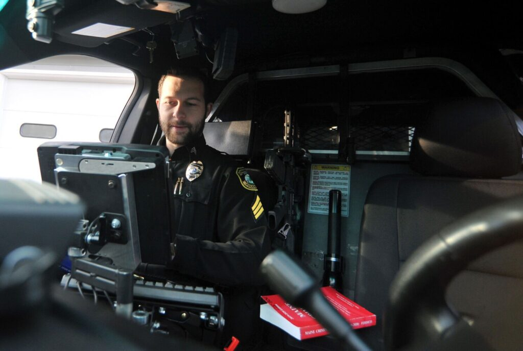 Fairfield police Sgt. Patrick Mank directs an internship program for aspiring officers. Much of the internship program involves field training. Mank directs the training from the front passenger seat of the patrol car, where he is pictured in Fairfield on Monday.