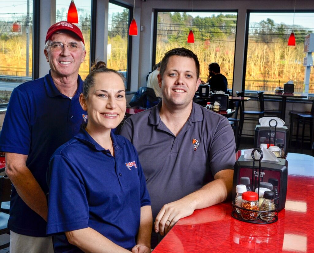 Partners Glenn Steuber, left, Janice Partridge and Glenn Partridge pose for a portrait in the dining room Thursday at their recently opened Cappza's Pizza in Farmingdale.