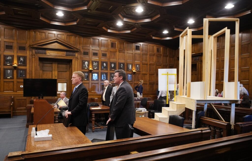 Jim Mason, left, and Jim Andrews, attorneys for Noah Gaston, and others prepare to leave the courtroom Thursday after being told by Justice Michaela Murphy that the room had to be cleared so the jury could come in to review the replica stairs and mock gun that were part of the trial.