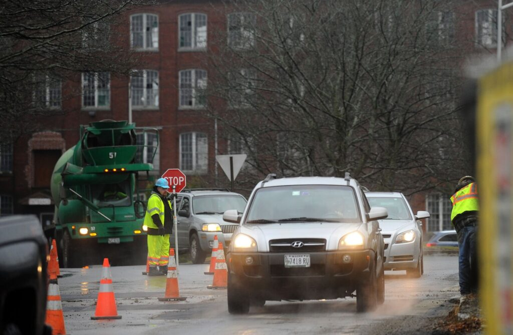 Traffic is squeezed Friday on Front Street by the Lockwood Hotel construction site in Waterville. Scheduled construction and a celebration of the completion of steel work on Monday morning may well add to the congestion of the morning commute.