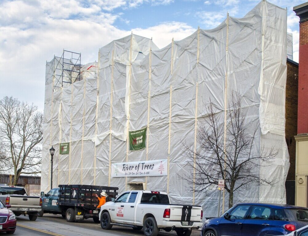 The scaffolding in front of The Colonial Theater is wrapped in plastic sheeting on Wednesday in downtown Augusta.