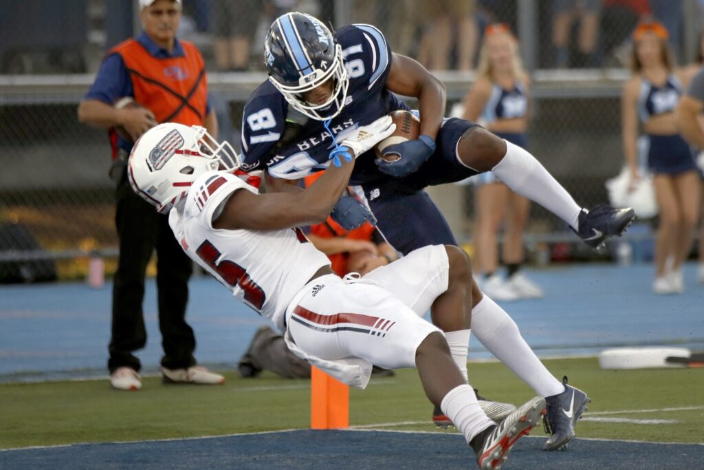 UMaine senior Earnest Edwards makes one of his nine touchdown catches this season. (Staff photo by Ben McCanna/Staff Photographer)