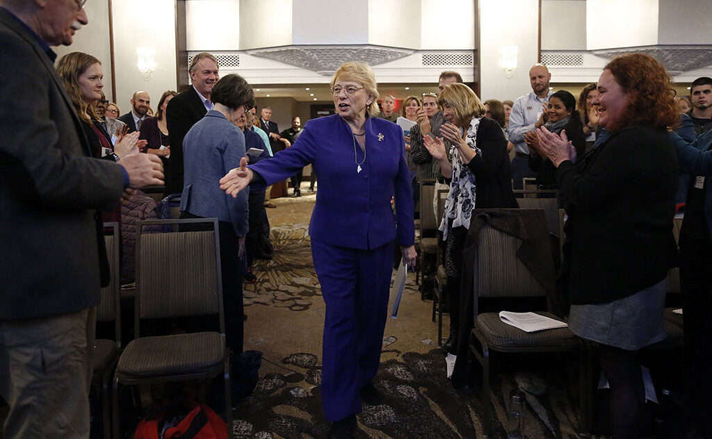 Gov. Janet Mills shakes hands with attendees before delivering opening remarks Monday at the Gulf of Maine 2050 International Symposium at the Westin Portland Harborview. Mills has set a goal of reducing Maine's greenhouse gas emissions by 80 percent from 1990 levels by 2050.