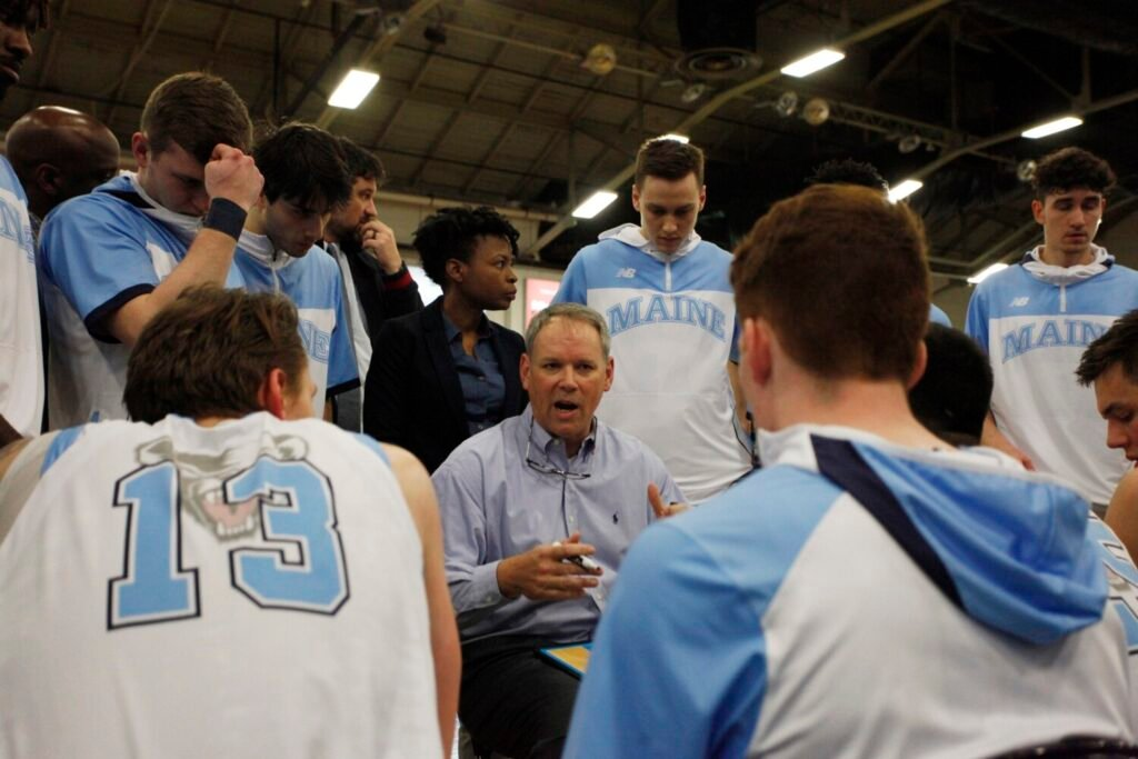 Maine men's basketball coach Richard Barron talks to his team before a game last year against Maine Maritime at the Portland Expo.