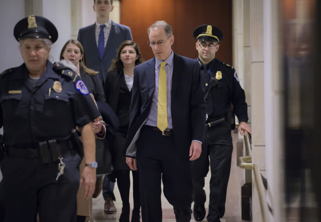 Mark Sandy, a career employee in the White House Office of Management and Budget, arrives at the Capitol to testify in the House Democrats' impeachment inquiry on Nov. 16.
