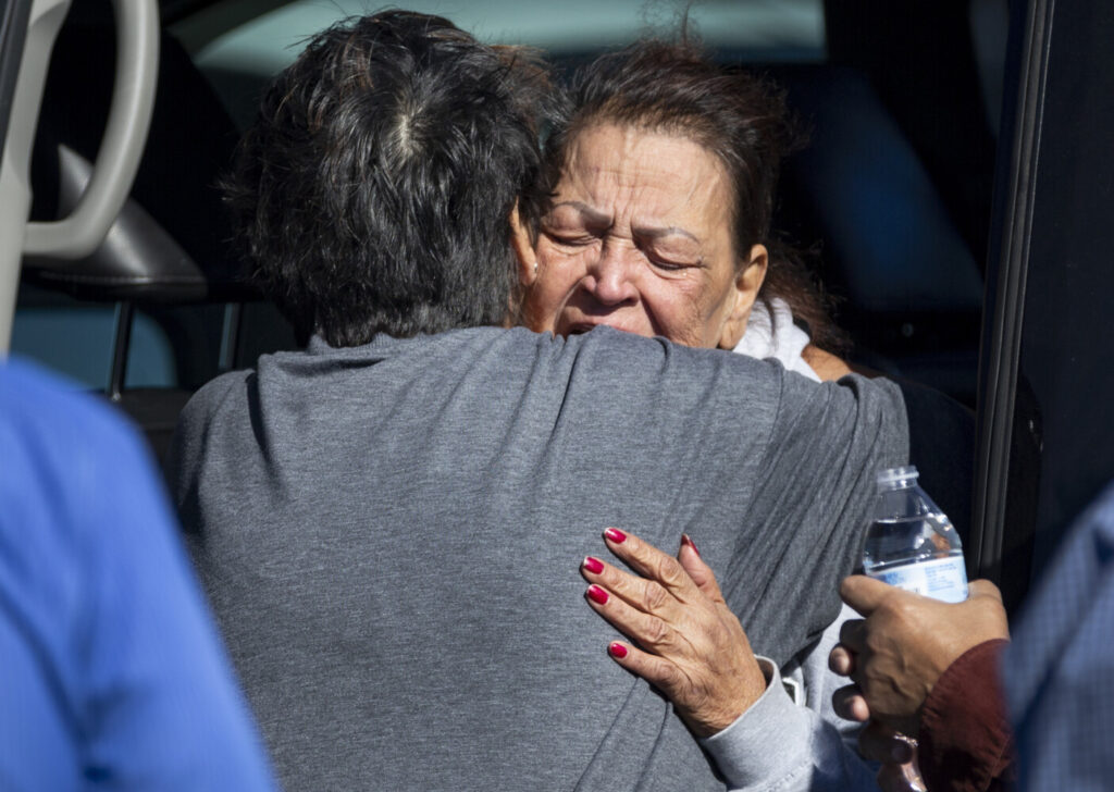 A family member reacts at the scene of a fatal shooting in the parking lot of a Walmart in Duncan, Okla., on Monday.