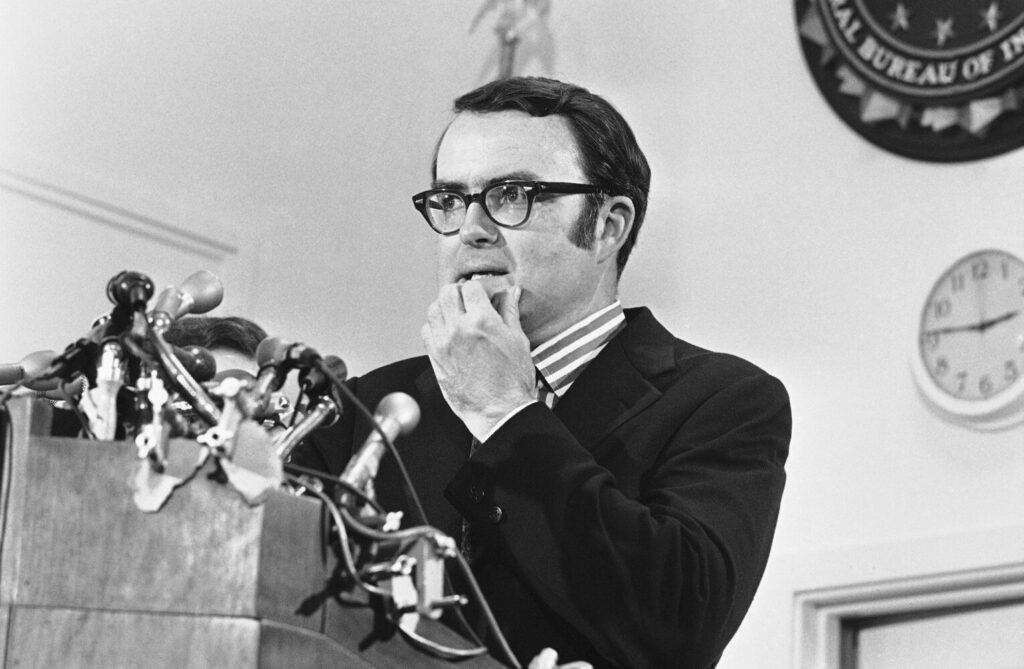 In this May 15, 1973, photo, then-acting FBI director William Doyle Ruckelshaus pauses during a news conference in Washington. In 2008, Time magazine rated Ruckelshaus among the best Cabinet secretaries in U.S. history.
