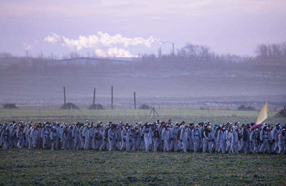Supporters of the climate movement Ende Gelaende protest in front of a coal-fired power station near Leipzig, Germany, on Nov. 24. Ende Gelaende is an action alliance for an immediate coal exit, climate justice and a fundamental system change.