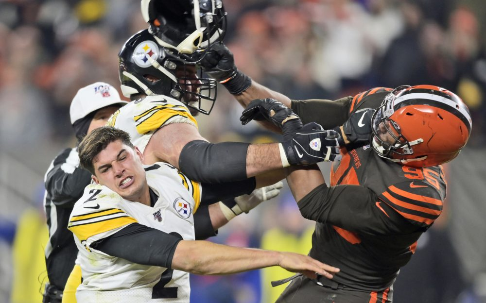 Cleveland Browns defensive end Myles Garrett hits Pittsburgh quarterback Mason Rudolph with a helmet in a game on Nov. 14, 2019, in Cleveland.