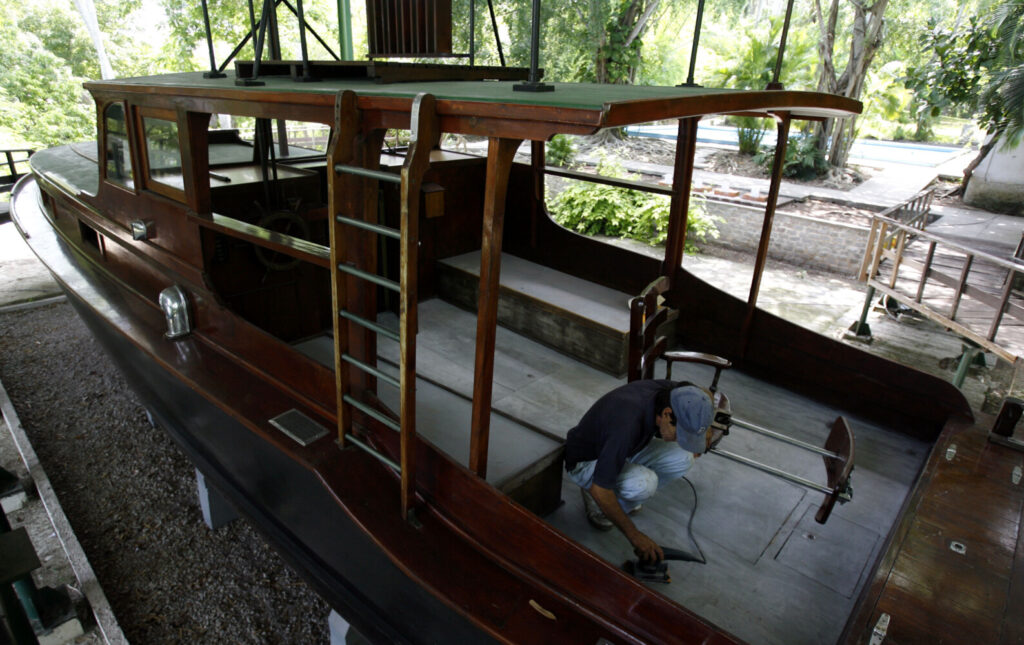 A worker polishes the Pilar, a 40-foot fishing boat that belonged to late American writer Ernest Hemingway (1899-1961) at his former home that is now a museum in Finca Vigia, Cuba, in 2008.