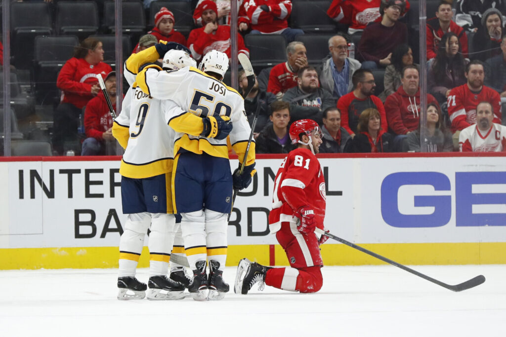 Nashville Predators center Matt Duchene  celebrates his goal with Filip Forsberg, left, and Roman Josi, center, as Detroit Red Wings center Frans Nielsen kneels on the ice during the Predators' 6-1 win Monday in Detroit.