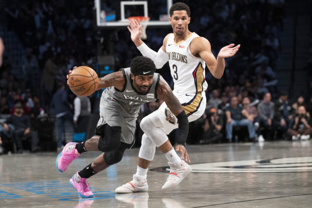 Nets guard Kyrie Irving drives to the basket against Pelicans guard Josh Hart on Monday in New York. Irving scored 39 points and Brooklyn won 135-125.