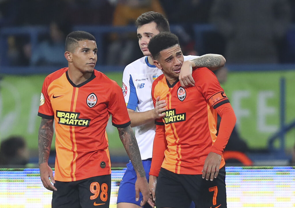Shakhtar's Brazilian player Taison, right, reacts as he leaves the pitch after he was red-carded for his reaction on racial abuse, while Dynamo Kyiv Mykola Shaparenko, center, calmed him down, during Premier League soccer match in Kharkiv, Ukraine, on Nov. 10, 2019. Shakhtar's Dodo, left, looks on.
