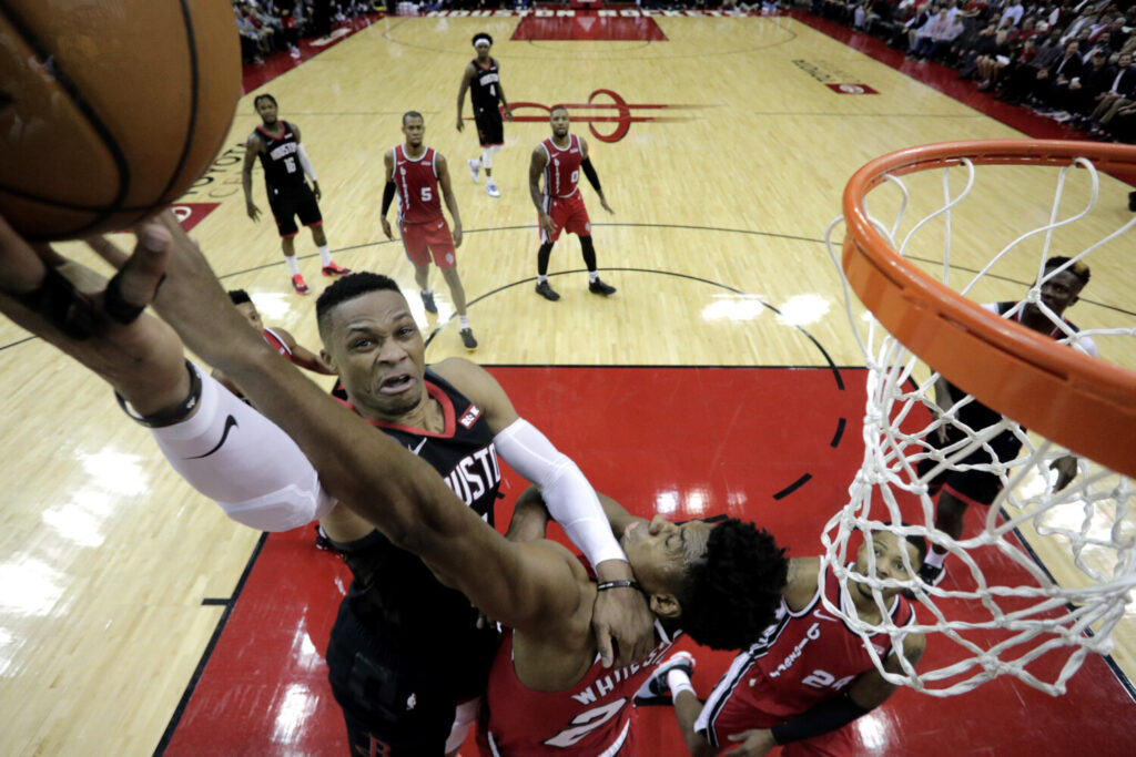 Houston's Russell Westbrook had 38 points, 13 rebounds and 10 assists in the Rockets' 132-108 win over Portland on Monday in Houston.
