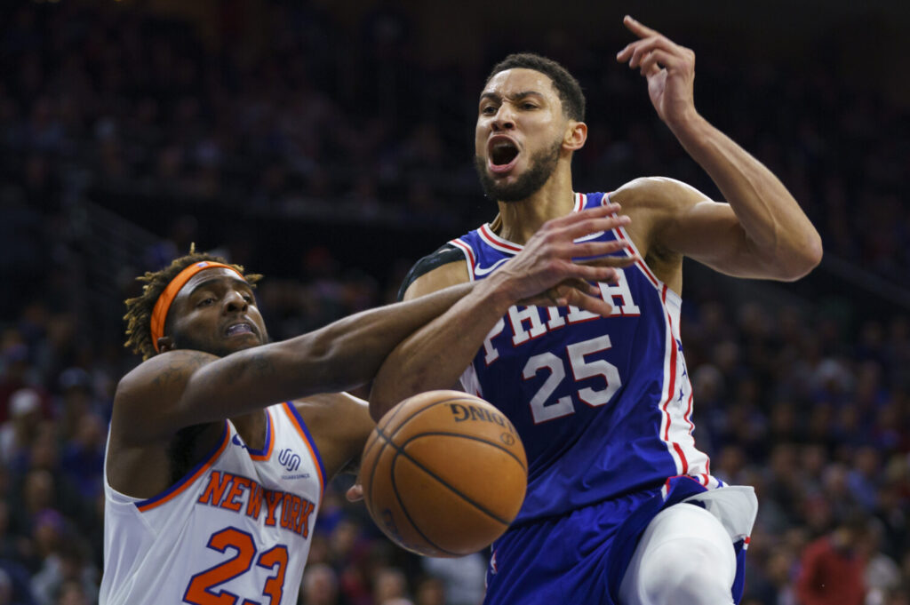 Ben Simmons, right, reacts to being fouled by New York's Mitchell Robinson, during the second half of Philadelphia's win over the visiting Knicks.